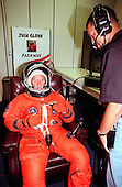 STS-95 Payload Specialist John H. Glenn Jr., senator from Ohio, tests the fitting of his flight suit in the Operations and Checkout Building while suit tech George Brittingham watches. The final fitting takes place prior to the crew walkout and transport to Launch Pad 39B. Targeted for launch at 2 p.m. EST on October 29, 1998, the mission is expected to last 8 days, 21 hours and 49 minutes, and return to KSC at 11:49 a.m. EST on Nov. 7. The STS-95 mission includes research payloads such as the Spartan solar-observing deployable spacecraft, the Hubble Space Telescope Orbital Systems Test Platform, the International Extreme Ultraviolet Hitchhiker, as well as the SPACEHAB single module with experiments on space flight and the aging process.Credit: NASA via CNP
