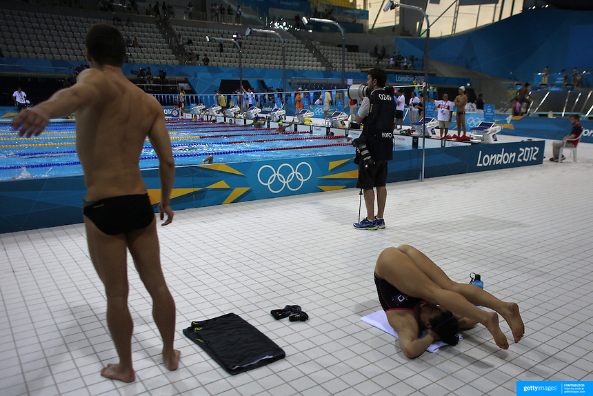 Swimmers Stretching Before Swimming At The Aquatic Centre At Olympic Park Stratford During The