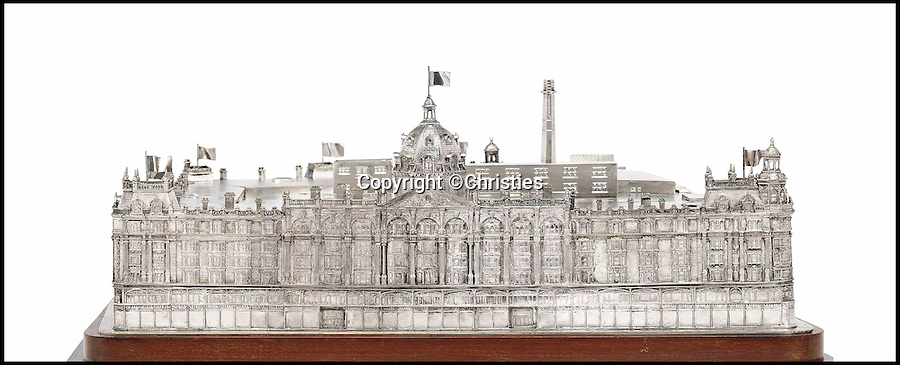 BNPS.co.uk (01202 558833)<br /> Pic: Christies/BNPS<br /> <br /> ***Please Use Full Byline***<br /> <br /> <br /> A silver cigar case in the shape of department store Harrods that was paid for by the owner of rivals Selfridge's following a bizarre bet is tipped to sell for 100,000 pounds.<br /> <br /> The intricate case was commissioned as a result of the wager between the then Harrods' managing director Sir Richard Woodman Burbidge and Harry Gordon Selfridge in 1917.<br /> <br /> The pair each bet their store would be more successful than the other by the time six years had passed from the end of the First World War.<br /> <br /> The case has been in the family of Sir Richard, who won the bet, ever since and is now being sold at Christie's in London.