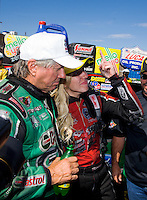 Jul. 27, 2014; Sonoma, CA, USA; NHRA funny car driver Courtney Force (right) gets emotional as she dedicates the win to the late Eric Medlen as she stands with her father John Force after winning the Sonoma Nationals at Sonoma Raceway. Mandatory Credit: Mark J. Rebilas-