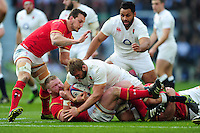 Chris Robshaw of England is tackled to ground. RBS Six Nations match between England and Wales on March 12, 2016 at Twickenham Stadium in London, England. Photo by: Patrick Khachfe / Onside Images