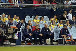 15 October 2014: U.S. head coach Jill Ellis (front row, left) with her staff and reserve players. The United States Women's National Team played the Trinidad and Tobago Women's National Team at Sporting Park in Kansas City, Kansas in a 2014 CONCACAF Women's Championship Group A game, which serves as a qualifying tournament for the 2015 FIFA Women's World Cup in Canada. The United States won the game 1-0.