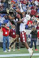 Annapolis, MD - December 27, 2016: Temple Owls defensive back Derrek Thomas (21) breaks up a pass attended for Wake Forest Demon Deacons wide receiver Scotty Washington (7) during game between Temple and Wake Forest at  Navy-Marine Corps Memorial Stadium in Annapolis, MD.   (Photo by Elliott Brown/Media Images International)