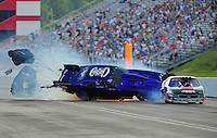 Jun. 18, 2011; Bristol, TN, USA: NHRA pro mod driver Roger Burgess crashes behind Kenny Lang during eliminations at the Thunder Valley Nationals at Bristol Dragway. Mandatory Credit: Mark J. Rebilas-