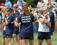 "The University of Virginia women's lacrosse team wore memorial t-shirt that said ""one team, one heart, one love"" before their first game since the tragic death of teammate Yeardley Love Sunday May 16, 2010 at Klockner Stadium in Charlottesville, Va. The Cavaliers rallied in the last four minutes to beat Towson 14-12 and reach the quarter finals of the NCAA tournament. Love's body was found May 3, and Virginia men's lacrosse player George Huguely is charged with murder. Photo/Andrew Shurtleff.."