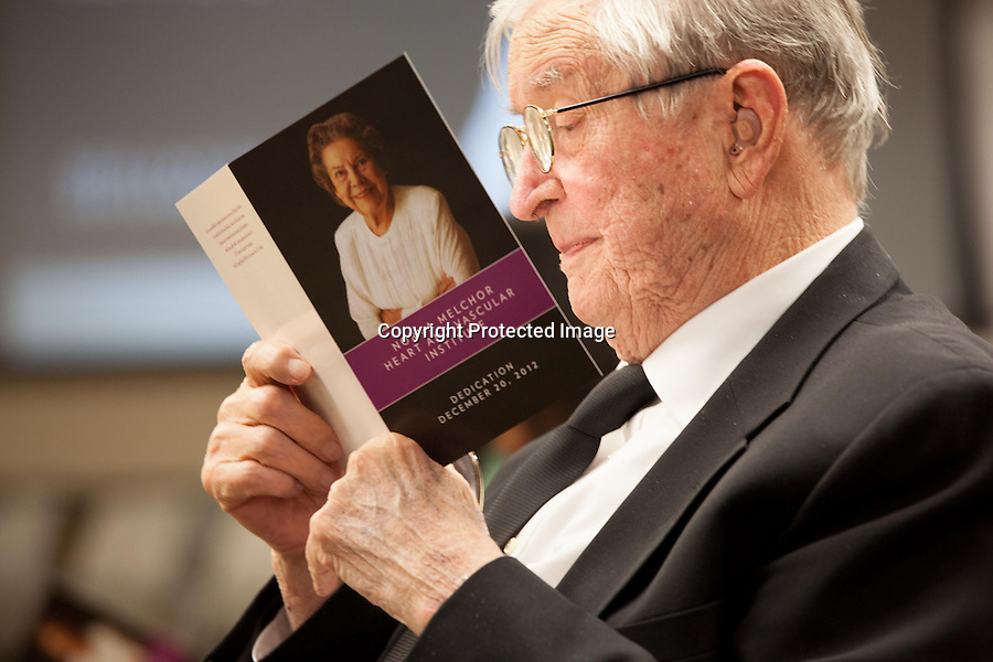 Jack Melchor reads a program before the dedication of a hospital program in honor of his wife, Norma Melchor. Melchor, a former surgical nurse and ardent supporter of the hospital for more than 50 years, died Feb. 17 at the age of 87.<br /> <br /> Photo by Ellie Van Houtte/Town Crier