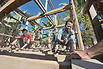 In the Cambodian village of Somrith, men work constructing a community rice bank sponsored Community Health and Agricultural Development program of the Methodist Mission in Cambodia.