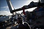 © Remi OCHLIK/IP3 - Port au Prince on 2010 november 23 - Haiti counted down towards weekend elections Monday as the death toll from a spiraling cholera epidemic neared 1,350, fueling debate over delaying the key polls in the quake-hit nation. Daily life in aviation refugees camp, former military airport where tens of old planes and helicopter are abandonned among tents