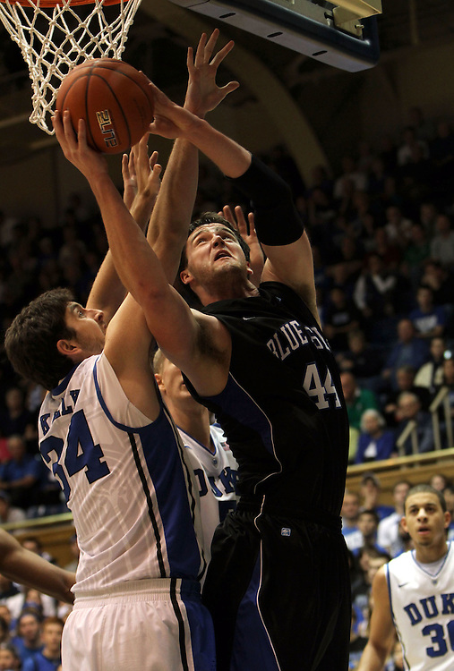 Presbyterian's Jay Renolds shoots over Ryan Kelly. Duke beat Presbyterian 96-55 on Saturday, November 12, 2011 at Cameron Indoor Stadium in Durham, NC. It was win number 902 for Duke head coach Mike Krzyzewski, tying him with Bob Knight for the NCAA Division I all-time win record. Photo by Al Drago.