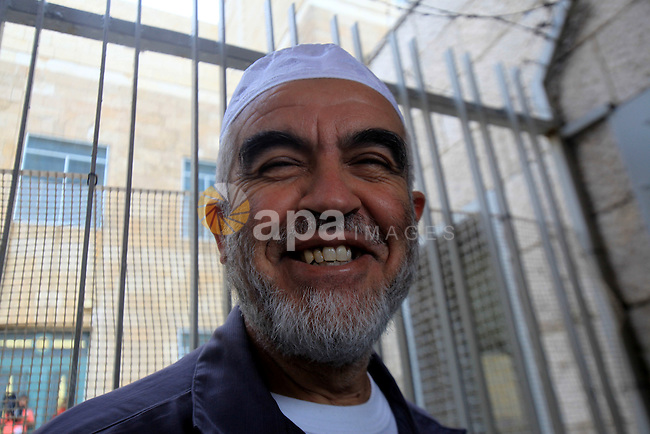 Leader of the radical northern wing of the Islamic Movement in Israel, Sheikh Raed Salah, poses for a photograph outside a Jerusalem court after he was convicted on October 27, 2015. An Israeli court upheld a conviction of the firebrand Islamic cleric and jailed him for 11 months for inciting violence over Jerusalem's Al-Aqsa mosque in 2007. Photo by Mahfouz Abu Turk