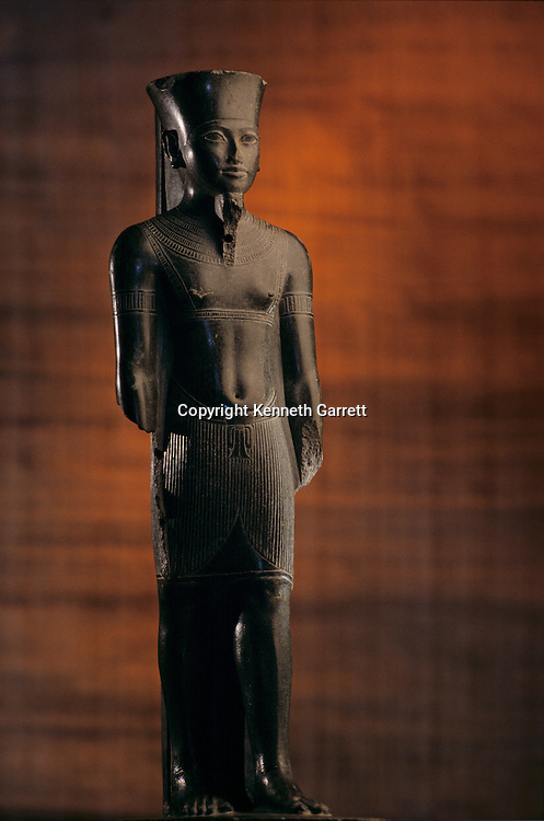 Staue of Amun with Tutankhamun's features, Tutankhamun and the Golden Age of the Pharaohs, Page 224