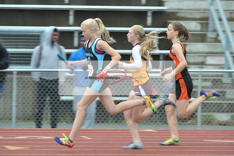 Chugiak's Emma Sees leads a group of 4x400 relay runners at the Region IV Track and Field Championships.  Photo by Michael Dinneen for the Star