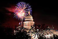 Colorful fireworks paint the sky over the Texas State Capitol on Texas Independence Day