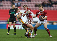 Huddersfield Giants' Paul Clough stopped in his tracks by Wigan Warriors' Sam Powell <br /> <br /> Photographer Stephen White/CameraSport<br /> <br /> Betfred Super League Round 5 - Wigan Warriors v Huddersfield Giants - Sunday 19th March 2017 - DW Stadium - Wigan<br /> <br /> World Copyright &copy; 2017 CameraSport. All rights reserved. 43 Linden Ave. Countesthorpe. Leicester. England. LE8 5PG - Tel: +44 (0) 116 277 4147 - admin@camerasport.com - www.camerasport.com