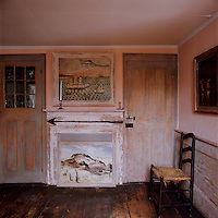 An upstairs parlour continues the distressed paint effect prevalent in other rooms in the cottage