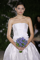 Model walks runway in a Tayane wedding dresses by Carolina Herrera, for the Carolina Herrera Bridal Spring 2012 runway show.