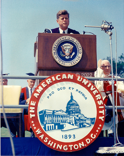 """United States President John F. Kennedy speaks at the American University commencement in Washington, D.C.  on June 10, 1963.  This speech is known as Kennedy's """"Pax Americana"""" speech, where he outlined his vision for world peace..Credit: Arnie Sachs / CNP"""
