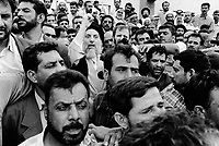 Iraq. Basrah. The crowd celebrates the return of exile after 23 years in Iran of the shia ayatollah Mohammed Baqer el-Hakim, leader of the Supreme Council for Islamic Revolution in Iraq. He just crossed by car the border a few hours ago. He wears a black turban on his head and has a beard. He speaks to the crowd  using a mike. Mohammed Baqer el-Hakim has been killed in a car bomb attack in Najaf on august 29 2003. Assasination attempt.  © 2003 Didier Ruef / pixsil.com