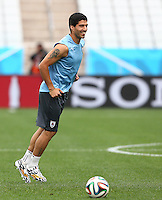 Luis Suarez of Uruguay smiles as he trains in the Arena Corinthians, Sao Paulo ahead of his sides Group D crunch fixture vs England tomorrow
