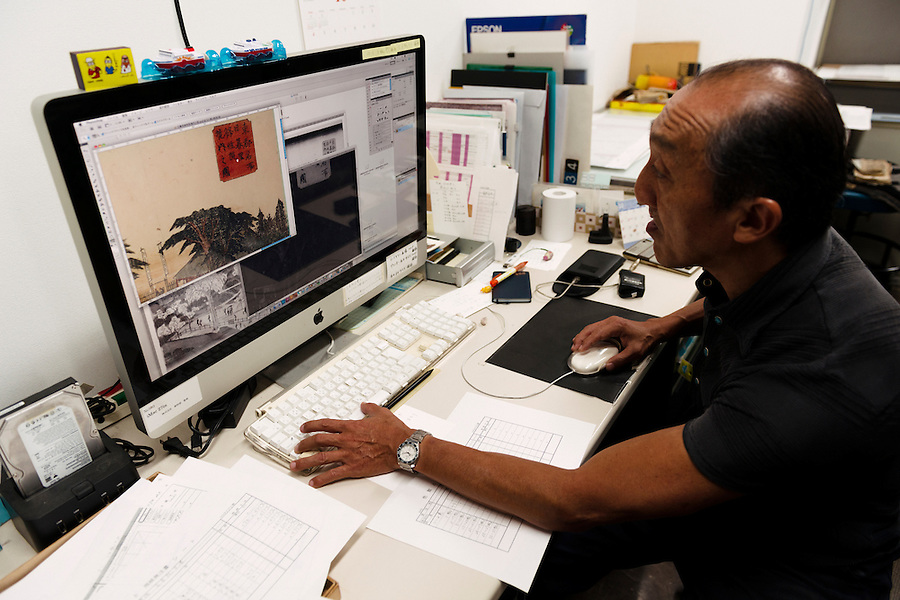 Computer retouching of a photograph to be used in the printing process. Benrido collotype atelier, Kyoto, Japan, October 13, 2015. The Benrido collotype atelier in Kyoto was founded in 1887 and is the only full-scale commercial collotype atelier in the world. Collotype is a historic photographic printing process that makes use of plates coated in gelatine. It produces prints of unrivalled quality.