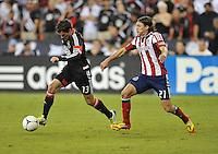 D.C. United midfielder Chris Pontius (13) goes against Chivas USA defender Ben Zemanski (21) D.C. United defeated Chivas USA 1-0 at RFK Stadium, Sunday September 23, 2012.