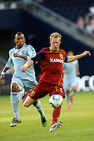 Real Salt Lake defender Nat Borchers clears the ball... Sporting Kansas City defeated Real Salt Lake 2-0 at LIVESTRONG Sporting Park, Kansas City, Kansas.