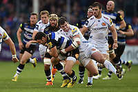 Jeff Williams of Bath Rugby is tackled by Ian Whitten of Exeter Chiefs. West Country Challenge Cup match, between Bath Rugby and Exeter Chiefs on October 10, 2015 at the Recreation Ground in Bath, England. Photo by: Patrick Khachfe / Onside Images