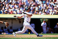 OAKLAND, CA - Jason Giambi of the Oakland Athletics bats during a game at the Oakland Coliseum in Oakland, California in 1996. Photo by Brad Mangin