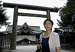 """Yuko Tojo, granddaughter of Japan's wartime leader, General Hideki Tojo, poses outside the main torii gate at Yaskuni Shrine in Tokyo. Gen. Hideki Tojo - who ordered the attack on Pearl Harbor -- was charged and hanged as a war criminal after World War II when Yuko was just 6, and he is enshrined inside the controversial Yasukuni Shrine together with 13 other convicted war criminals. Though she remembers little of her grandfather she still regards him as a hero. """"Japan did not fight a war of aggression but in self-defense,"""" says Ms. Tojo, widely seen as a leading figurehead in a recent surge in nationalism in Japan and who unsuccessfully ran for a seat in Japan's House of Councilors in 2007. """"Schoolchildren are told what evil things our country and their ancestors did during the war and this has led to a lack of pride in the Japanese people. This is wrong. We must reinstall a sense of pride and confidence in our children."""" Upon running for a seat in Japan's Upper House of Parliament, one of her main goals was to ensure all of Japan's war dead would be enshrined at the central Tokyo shrine."""
