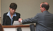 Prince William County (Virginia) assistant prosecutor Richard Conway, shows witness Carrie Turner a photo of a Chevrolet Caprice during her testimony in the trial of sniper suspect John Allen Muhammad in courtroom 10 at the Virginia Beach Circuit Court in Virginia Beach, Virginia on October 28, 2003.  Turner testified that she saw the car at the Leisure World Shopping Center in Silver Spring, Maryland, on October 3, 2002,  the day Sarah Ramos was killed. <br /> Credit: Adrin Snider - Pool via CNP