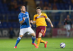 St Johnstone v Motherwell....31.10.14   SPFL<br /> Lee Croft is tackled by Iain Vigurs<br /> Picture by Graeme Hart.<br /> Copyright Perthshire Picture Agency<br /> Tel: 01738 623350  Mobile: 07990 594431