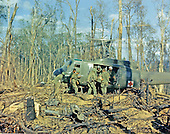 Dak To, Vietnam - November 23, 1967 -- Members of the Fourth Batallion, 173rd Airborne Brigade, load the wounded aboard a UH-1D helicopter for evacuation after the assault on Hill 875, located 15 miles west of Dak To, Vietnam on November 23, 1967..Credit: Alfred Batungbacal - U.S. Army via CNP