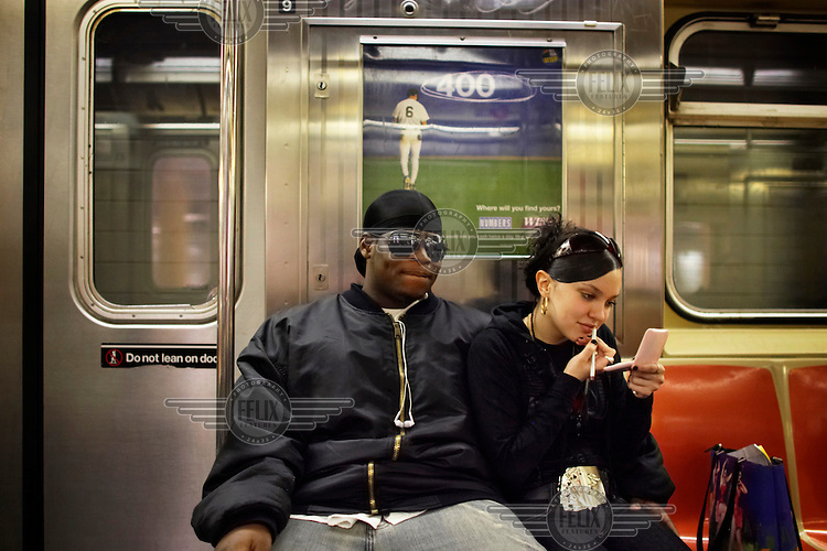 A man and his girlfriend ride the subway in the East New York part of Brooklyn.