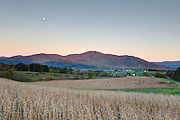 The moon sets over a rural farm at sunrise on the edge of the Shenandoah National Forest by Old Ragg Mountain in Madison County, Va. Photo/Andrew Shurtleff