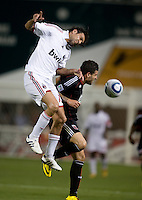 Allessandro Nesta (13) of AC Milan heads the ball away from Santino Quaranta (25) of D.C. United during a friendly at RFK Stadium in Washington, DC.  AC Milan lost to D.C. United, 3-2.