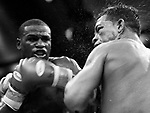 ARTURO GATTI (9/12) --&nbsp;Top-ranked contender Floyd Mayweather, Jr. (left) punishes Arturo Gatti with a stiff left hand in the sixth at Atlantic City's Boardwalk Hall.  Somehow, Gatti withstood the devastating beating this round and made it back to his corner. ATLANTIC CITY, NJ  6/25/05  11:45:45 PM
