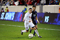 Jamie Thomas (17) of the St. John's Red Storm and Daniel Gonzalez (22) of the Villanova Wildcats. St. John's defeated Villanova 2-0 during the second semifinal match of the Big East Men's Soccer Championships at Red Bull Arena in Harrison, NJ, on November 11, 2011.