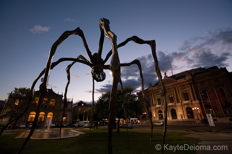 "A giant bronze spider, ""Maman"" by Louise Bourgeois on temporary display in front of the Music Conservatory at Place Neuve in Geneva, Switzerland"