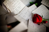 Oslo, Norway, 25.07.2011. A rose is placed alongside handwritten messages inside the Oslo Cathedral. On 22 July 2011, Anders Behring Breivik bombed the government buildings in Oslo, which resulted in eight deaths. He then carried out a mass shooting at a camp of the Workers' Youth League (AUF) of the Labour Party on the island of Ut&oslash;ya where he killed 69 people, mostly teenagers. Photo: Christopher Olss&oslash;n. ..----------------------------..-ITALY OUT-..----------------------------
