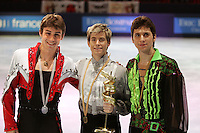 November 19, 2005; Paris, France; (L-R) Winners in mens figure skating are BRIAN JOUBERT of France (silver),  JEFFREY BUTTLE of Canada (gold), GHEORGHE CHIPER of Romania (bronze) at Trophee Eric Bompard, ISU Paris Grand Prix competition.  They are favorites in mens leading up to Torino 2006 Olympics.<br />