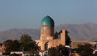 General view of Bibi-Khanym Madrasah and Mausoleum, 15th century, Samarkand, Uzbekistan, pictured on July 19, 2010, at dawn with mountains in the background. the mausoleum of Timur's wife is located opposite Mosque also named after her. Both have been extensively restored. Samarkand, a city on the Silk Road, founded as Afrosiab in the 7th century BC, is a meeting point for the world's cultures. Its most important development was in the Timurid period, 14th to 15th centuries. Picture by Manuel Cohen.