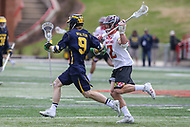 College Park, MD - April 1, 2017: Maryland Terrapins Colin Heacock (2) tries to stop Michigan Wolverines Christian Wolter (9) during game between Michigan and Maryland at  Capital One Field at Maryland Stadium in College Park, MD.  (Photo by Elliott Brown/Media Images International)