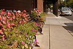 Colorful flower boxes line Main Street in Jacksonville, Oregon