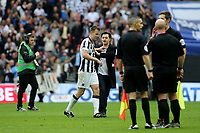 Millwall captain, Tony Craig, seems to push away a pitch invader at the end of the match during Bradford City vs Millwall, Sky Bet EFL League 1 Play-Off Final at Wembley Stadium on 20th May 2017