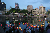 HIROSHIMA ATOMIC BOMBING 60TH ANNIVERSARY. Lanterns float on the river in front of the A-Bomb Dome, in Hiroshima for 60th anniversary of bombing..Hiroshima, Japan, 6th August 2005.