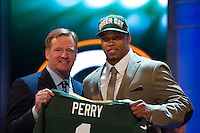 The 28th overall pick defensive end Nick Perry (Southern California) of the Green Bay Packers with NFL commissioner Roger Goodell during the first round of the 2012 NFL Draft at Radio City Music Hall in New York, NY, on April 26, 2012.