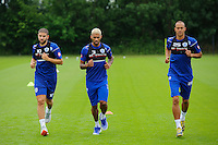 Adel Taarabt, Bobby Zamora and Armand Traore of QPR in training
