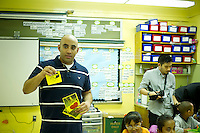 Teacher Mr. Mohamed Mamdouh displays flashcards to the students. First and second graders learn Arabic at P.S. 368-Hamilton Heights School in Harlem in New York on Wednesday, May 23, 2012. The program is the first at the K-5 school level in New York City Public Schools.  © Frances M. Roberts)