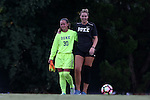 19 August 2016: Duke's EJ Proctor (30) and Abby Pyne (right). The Duke University Blue Devils played the Wofford College Terriers in a 2016 NCAA Division I Women's Soccer match. Duke won the game 9-1.