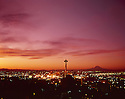 BI32,838-02...WASHINGTON - 1965 photograph of a sunrise over Seattle and the Space Needle with Mount Rainier in the distance.